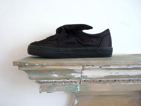 BLACK SATIN TIE BOW SLIP ON TRAINERS
