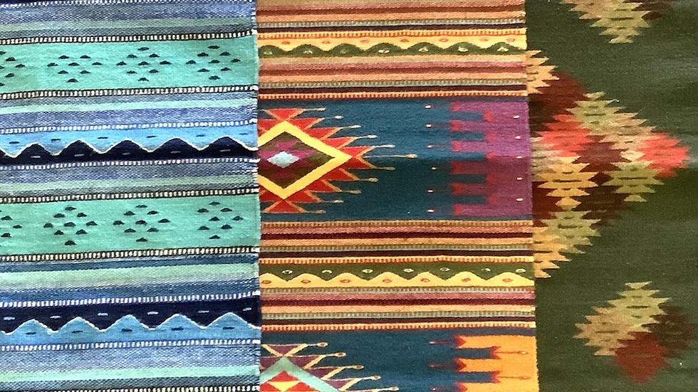 Zapotec rug dark teal orange and purple