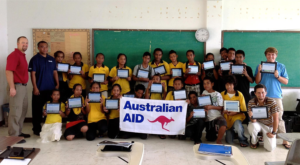 Our students at RSP Elementary School and a few MAHI International team members with iPads awarded by Australian AID.