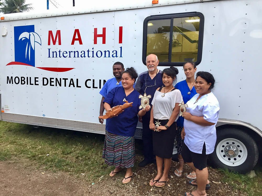 Dr. Pierson (back center) with local dentists and staff