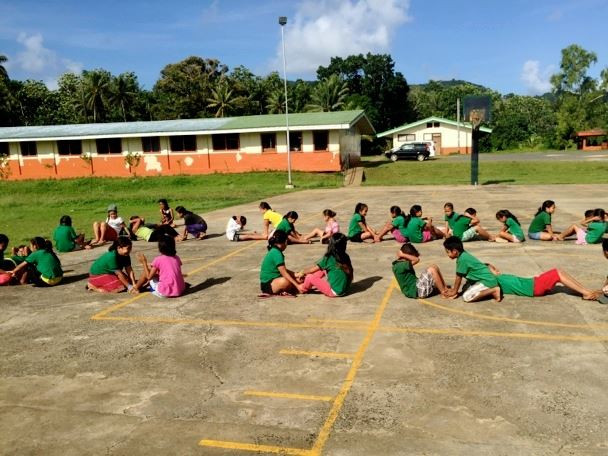 Students at Ohmine Elementary learn correct execution of exercise moves.