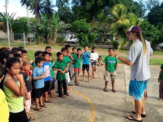 MAHI International volunteer Chapman Cochran teaches skills of physical education.