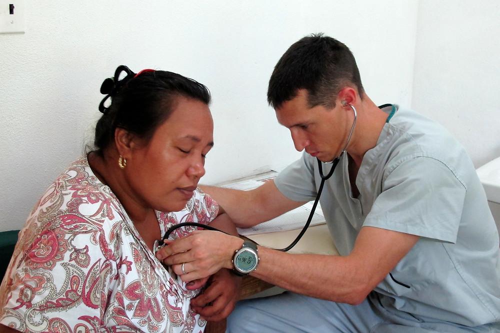 Dr. Joel Massey conducts a health screening.