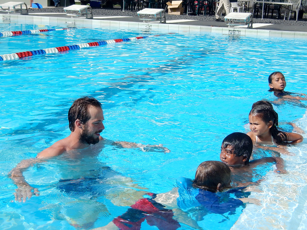 Nick Boyer teaches children how to swim.