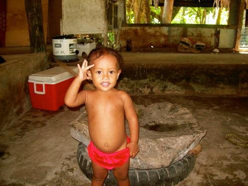 A local child at her home on Sapwuafik