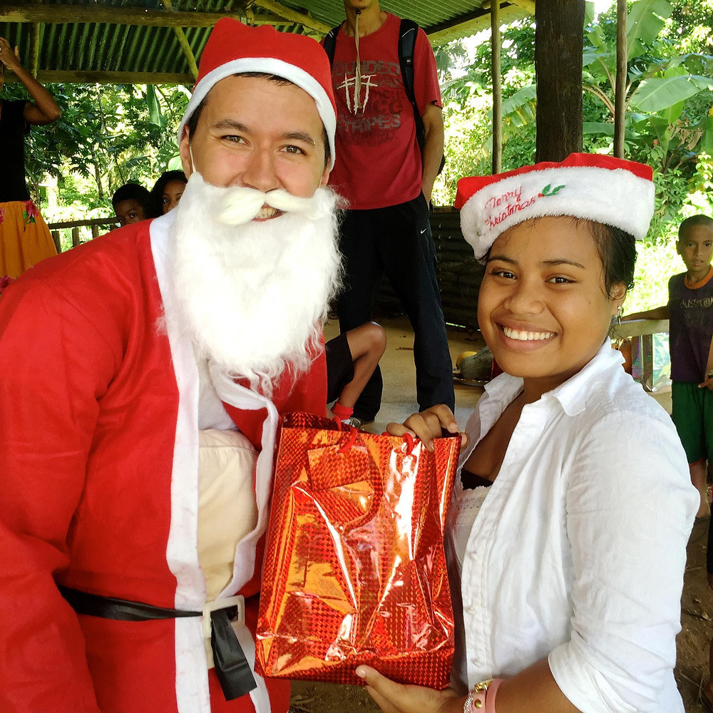 MAHI International's Christmas Cheer Project 2015 Thanks to North Hills Church, Claremont, CA.  MAHI volunteer Ryan poses as Santa and brings much delight to the children.