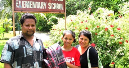 MAHI International volunteer Jennifer Silva (right) awards Spelling Bee Runner-up Natanya Jim (middle) with a new backpack.  Natanya is from our adopted school Pohnlangas Elementary School in Medelinowhm.  She is pictured here with her homeroom teacher (left).