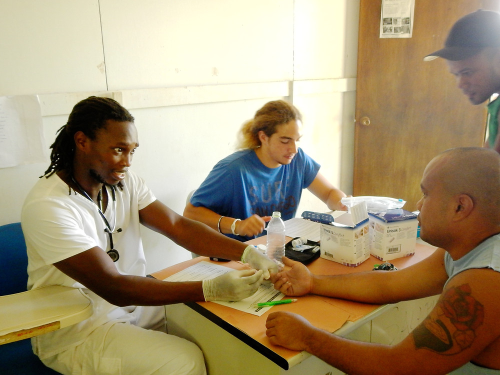 MAHI International long-term volunteers (from left to right) nurse Jeffrey Georges and new volunteer Chapman Cochran at work.