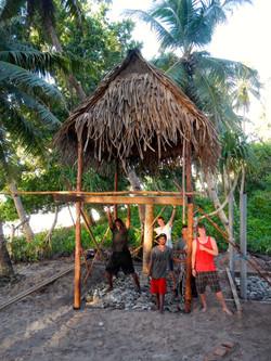 volunteers build housing for Sapwuafik english program