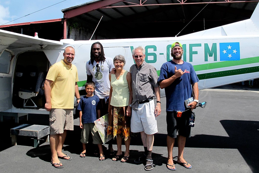 Mission team heads out by plane to the outer island of Sapwuafik. (Left to Right): John Schroer (and son Kai), Jeffrey Georges, Betty Jo Wresch, Robert Wresch, Nick Boyer.