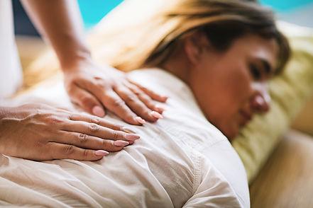 Reiki Therapist Balancing Chakras. Energ