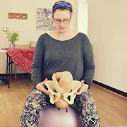 Doula Pippa Moss teaching active birth with pelvis and doll