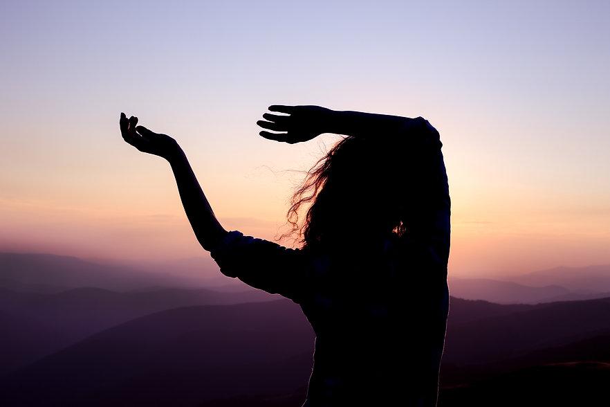 woman dancing purple mountains shutterst