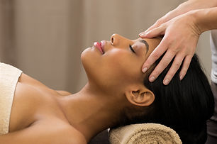 Closeup of young woman receiving professional head massage at spa .jpg
