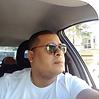 Tata Kitalelu homem negro de óculos escuro de camisa branca