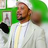 Perfil do Tata Mukumbi homem negro de barba trajando roupa e boina branca