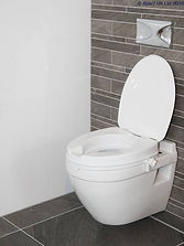 Raised toilet seat. Link to daily living aids