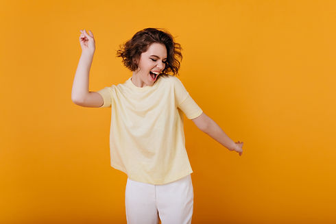Pale brown-haired girl in yellow t-shirt