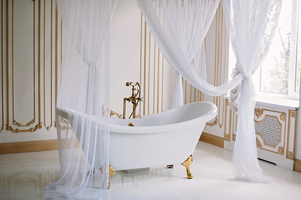 Gold Provence style bathtub with gold fi