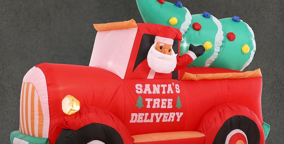 Kæmpe oppustelig pickup truck med juletræ og julemand