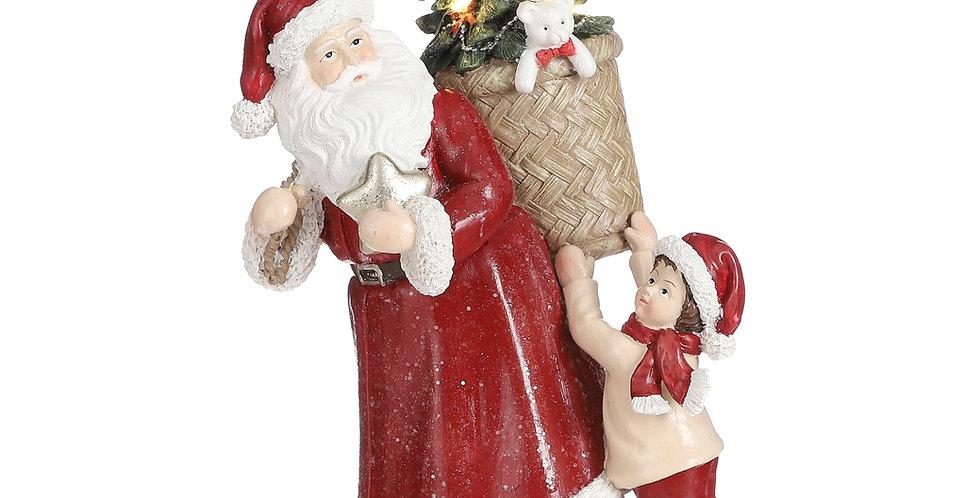 Julemand med led juletræ og barn