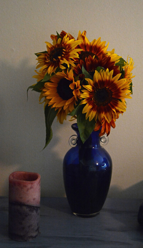 Sunflowers and a Candle