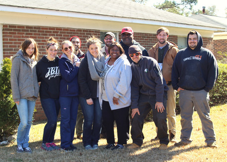 Volunteers Showing a Homeowner Love