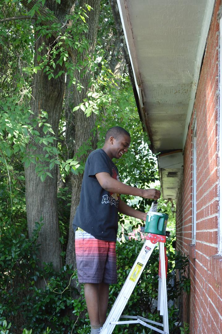 Volunteer Painting Trim
