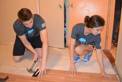 nCino employees repairing floors
