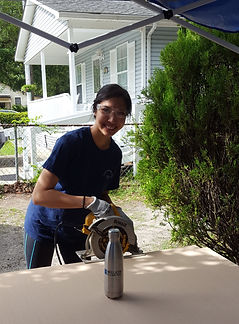 WARM NC Volunteer sawing