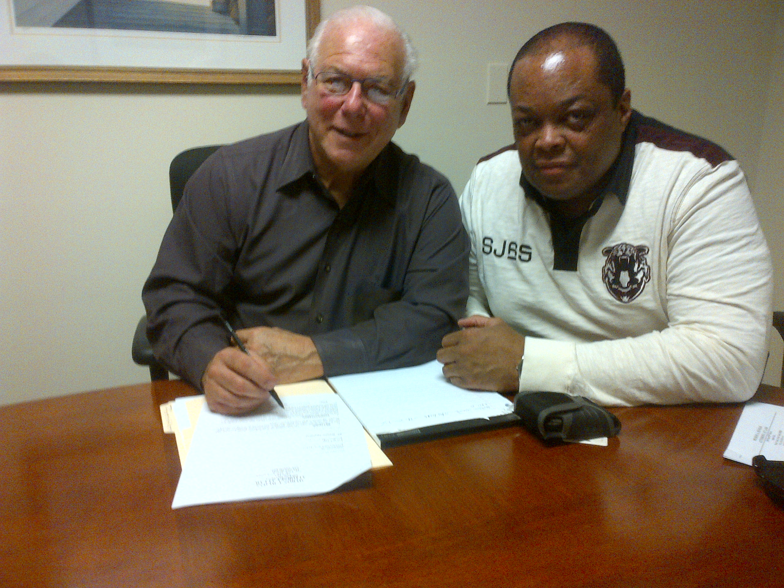 Attorney~Producer Micky Hyman with Producer Director Frazier discussing  paperwork for new Muhammad