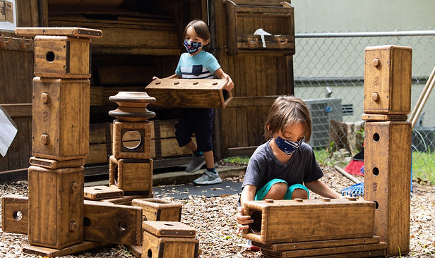 Students playing with building blocks outside