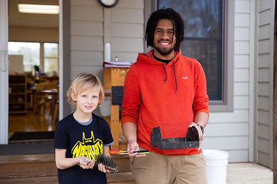 Student and teacher working outside