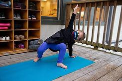 Student practising yoga outside