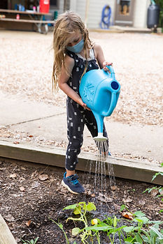 Student watering plants