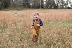 Student running through fields