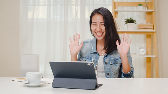 freelance-business-women-casual-wear-using-tablet-working-call-video-conference-with-custo