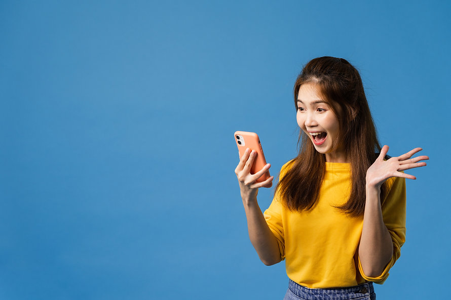 surprised-young-asia-lady-using-mobile-phone-with-positive-expression-smiles-broadly-dress