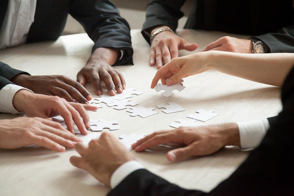 close-up-of-multiethnic-team-solving-bla