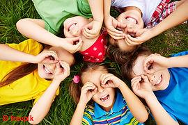 children-playing-grass.jpg