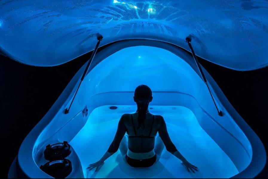A model sitting in a float tank
