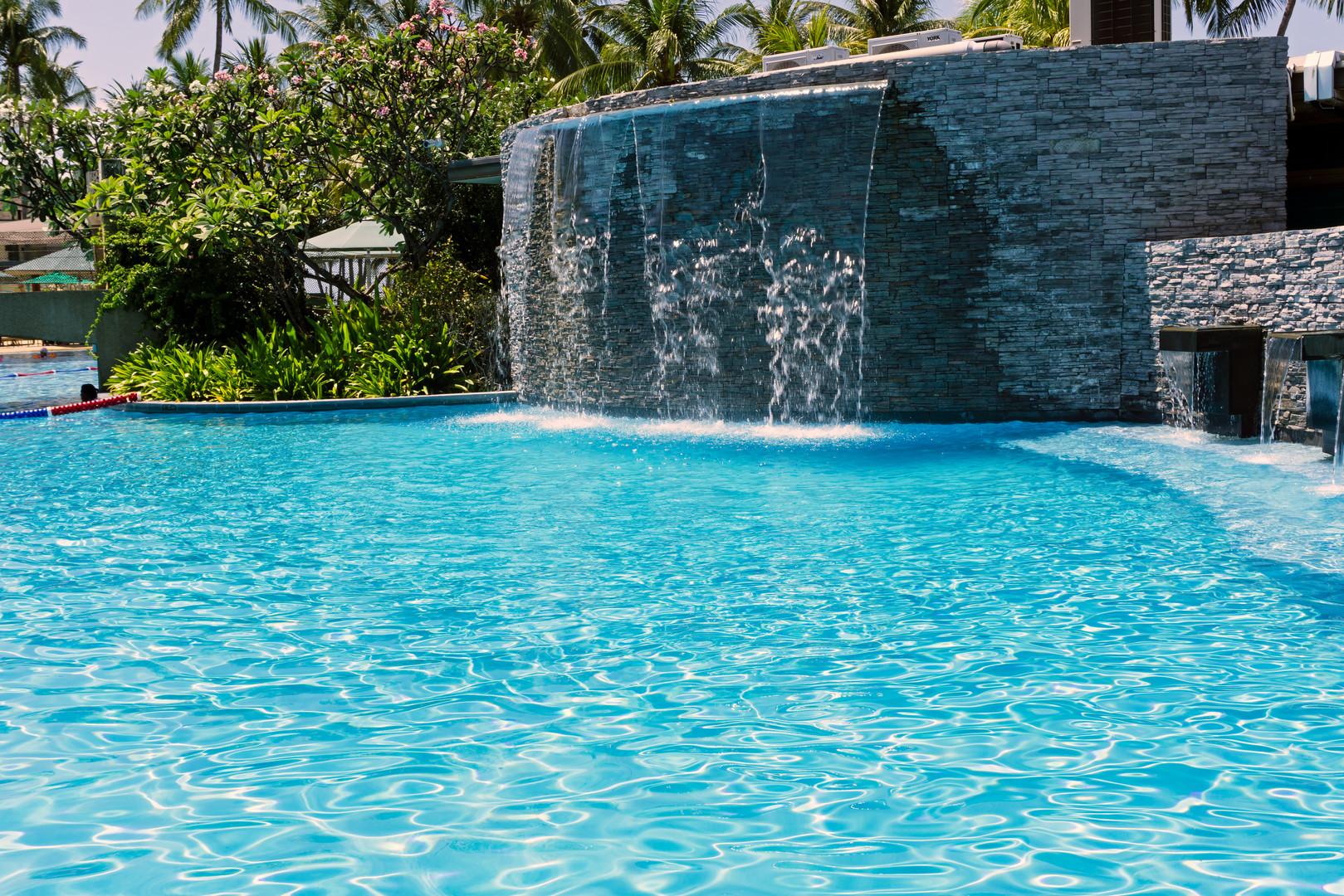 Man made waterfall at the swimming pool,