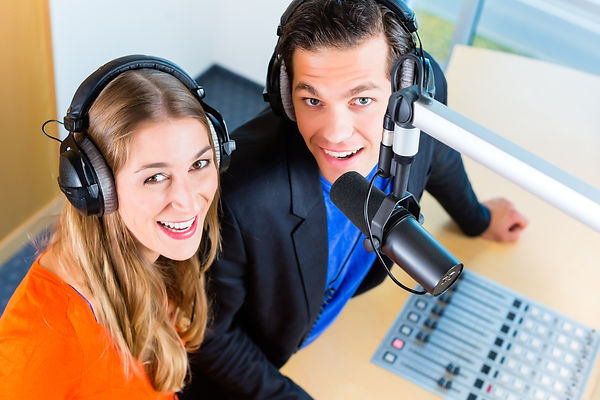 Presenters or moderators - man and woman