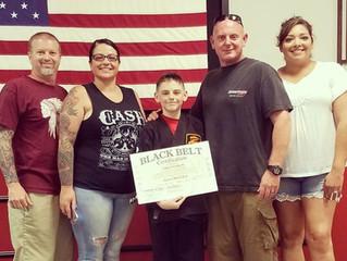 Congrats to Gage Craddock on his Junior Black Belt!  Way to go!