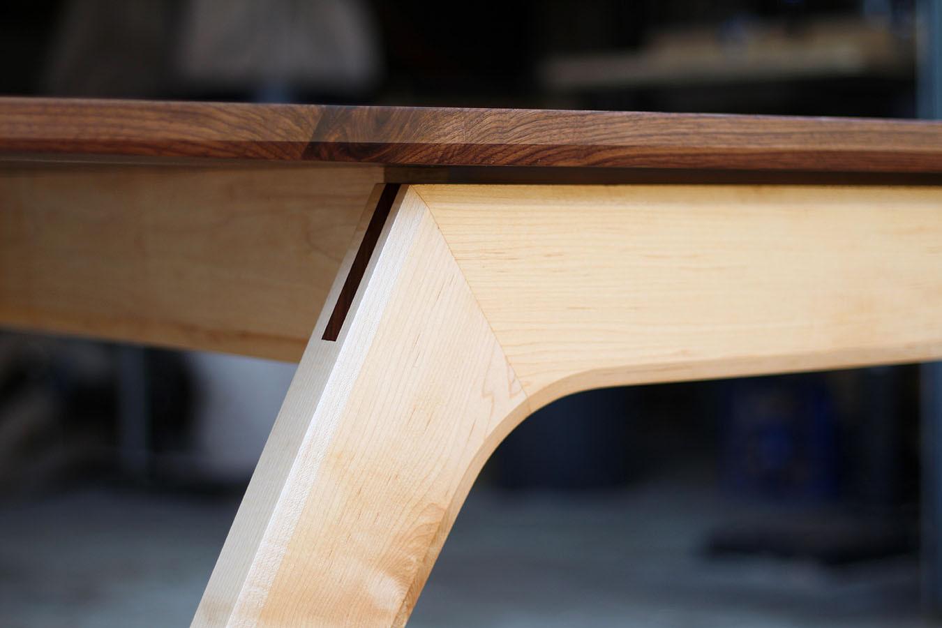 Asymmetrical dining table by David Cummi