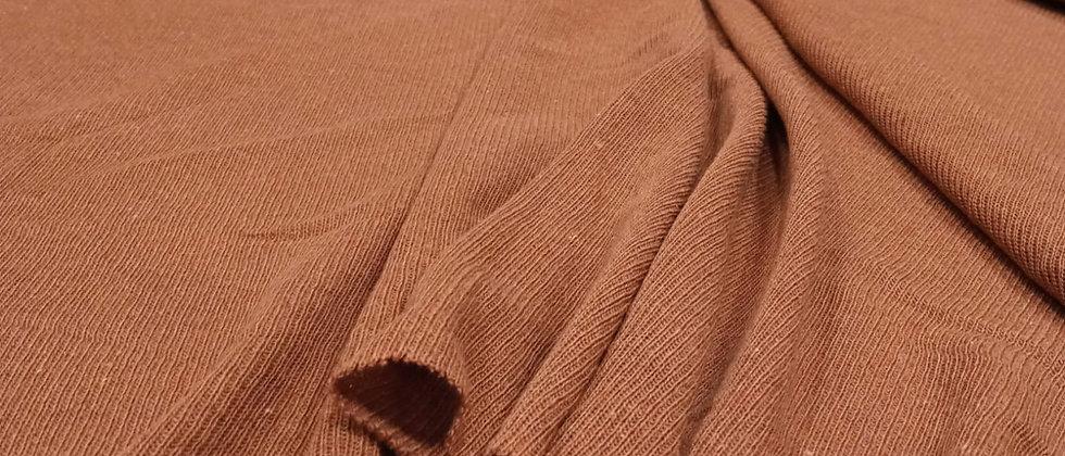 Punto marrón jersey