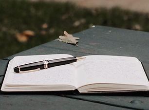 Blog - Notizbuch und Stift
