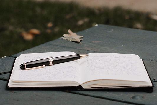 Kladblok en pen