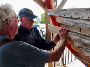 Alan and Richard test fitting new plank end