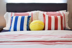 A bed with colorful pillows